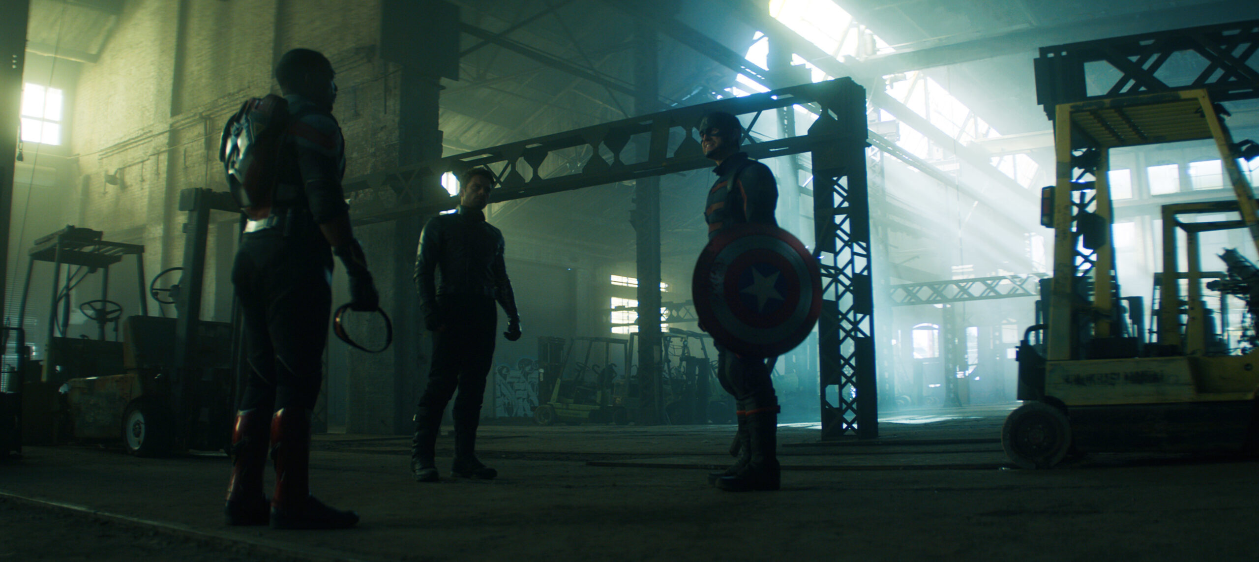 Sam, Bucky, and John Walker confront each other in a warehouse.